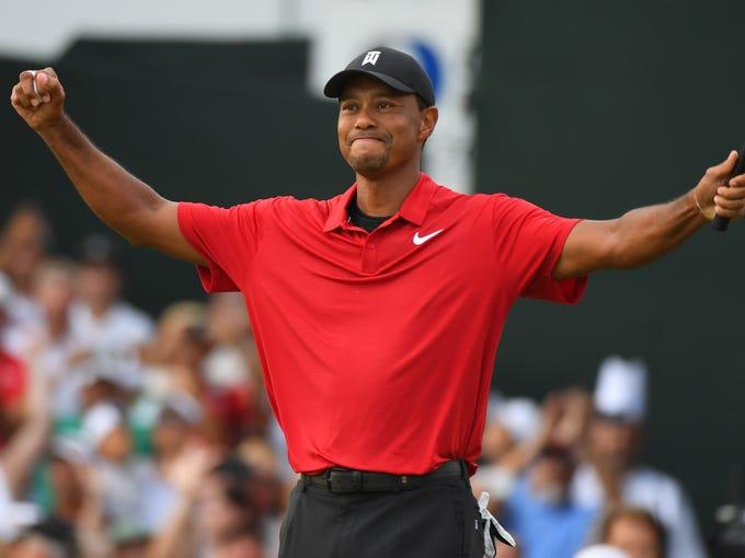 Sep 23, 2018; Atlanta, GA, USA;  Tiger Woods reacts
