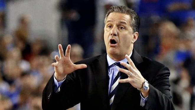 Kentucky Wildcats head coach John Calipari calls to players during the first half as the Kentucky Wildcats faced the Connecticut Huskies in the NCAA Final Four championship game at AT&T Stadium in Arlington, Texas, April 7, 2014.