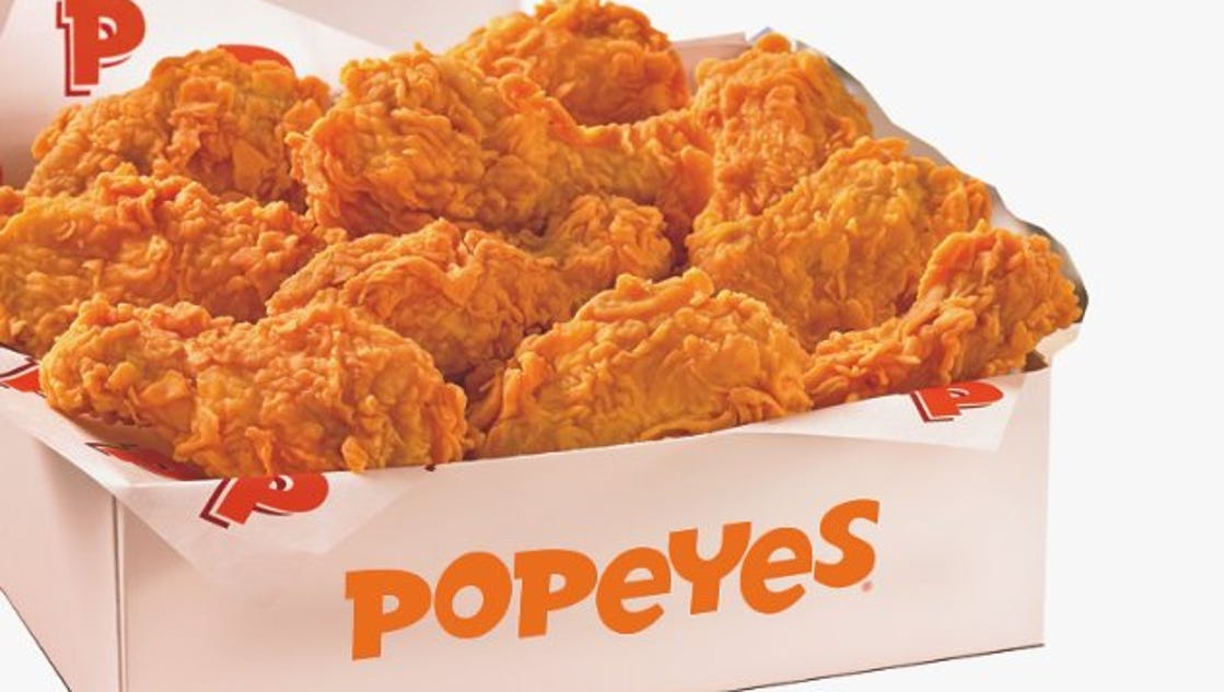 how to get a popeyes franchise