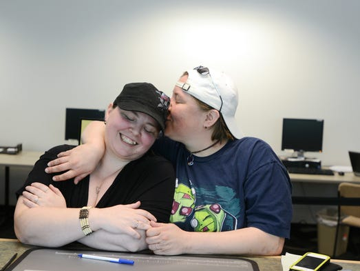 Michelle Hatfield (left) and Jammie Russell embrace while they apply for a marriage license at the Marion County Clerk's Office in downtown Salem on Monday, May 19, 2014.