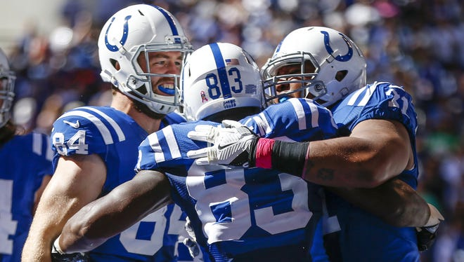 Indianapolis Colts tight end Dwayne Allen (83) celebrates with teammates after scoring a touchdown against the Chicago Bears during the first half at Lucas Oil Stadium on Oct. 9, 2016. The Colts improved to 2-3 with a 29-23 win.