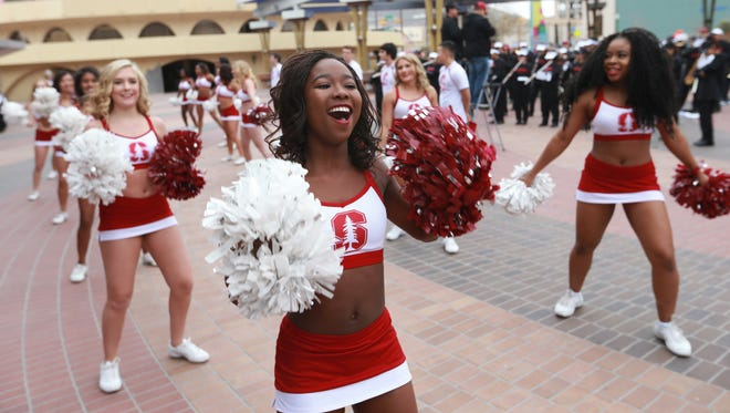 Cheerleaders drum up support for the Stanford Cardinal on Thursday at the El Paso convention center.