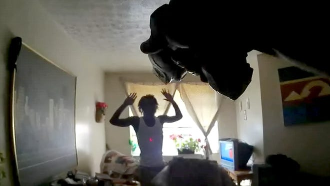 """Screen grab from body camera footage from an August. 8 incident. Two Cincinnati Police officers used """"horrible judgment"""" and may have violated department policy when they used their Tasers in an early August scuffle, say experts who reviewed bodycam footage obtained by The Enquirer. The Aug. 8 incident prompted an extraordinary intervention by the Hamilton County prosecutor in an external city investigation into the use of force and a major showdown between City Manager Harry Black and police union president Dan Hils. The incident involved two officers using their Tasers multiple times on two men who were in their mother's apartment in University Heights. The two men, who had no previous criminal record, have since pled guilty to resisting arrest and assaulting an officer. One was left with a collapsed lung, which came after he had spinal fusion surgery earlier thisyear."""