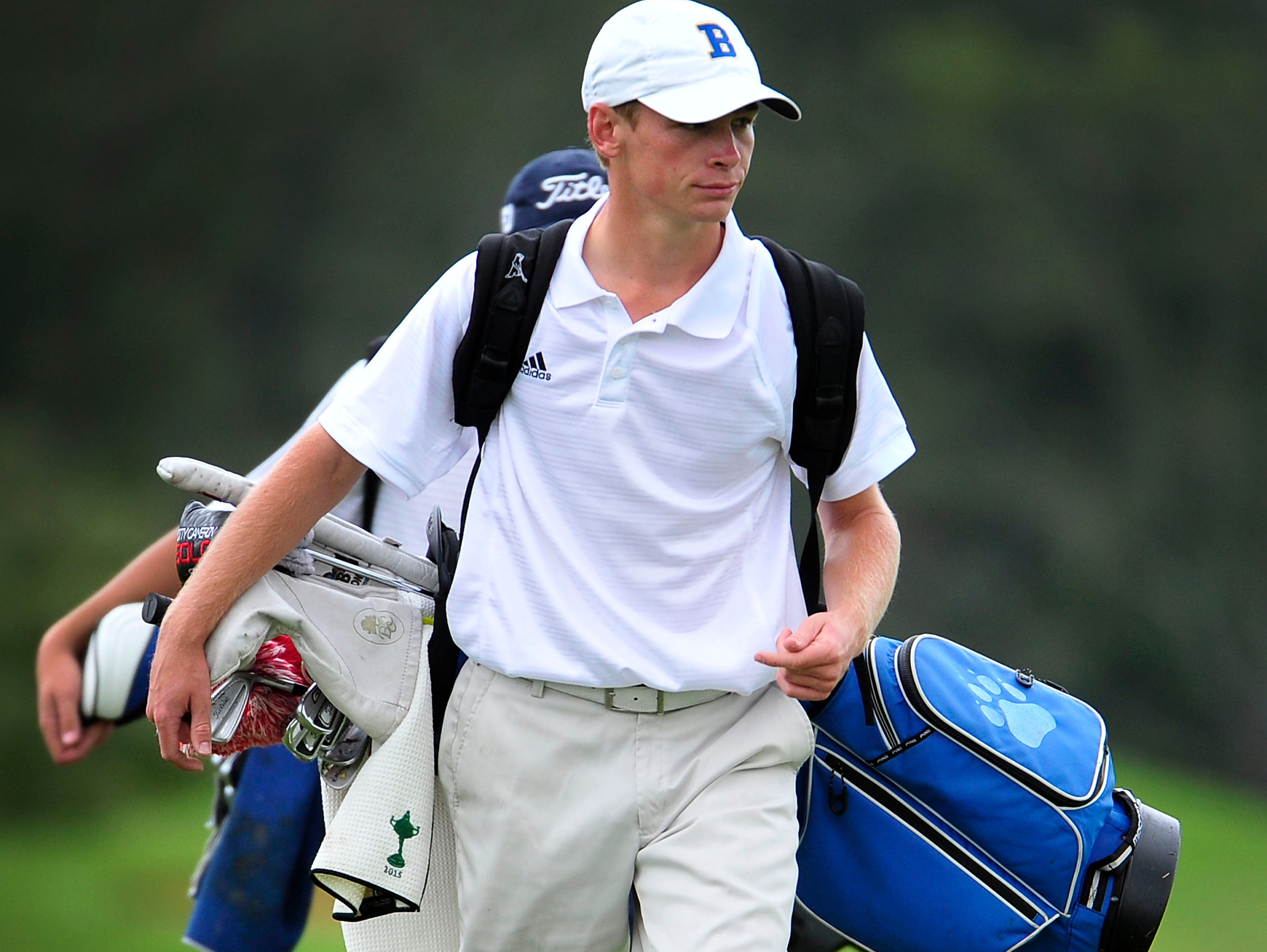Brentwood's Trevor Johnson walks to the eighth green during the Class AAA Golf Tournament at WillowBrook Golf Club in Manchester on Sept. 30, 2015.