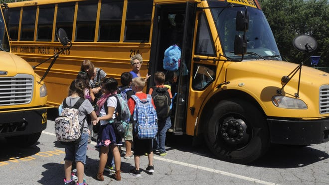 Students at Glenn C. Marlow elementary school prepare to head home after their first day of school in 2015.