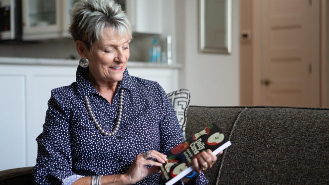 """Connie Mason Michaelis talks about her process to create her book, titled """"Daily Cures Wisdom for Healthy Aging"""" at her Topeka apartment Wednesday afternoon."""