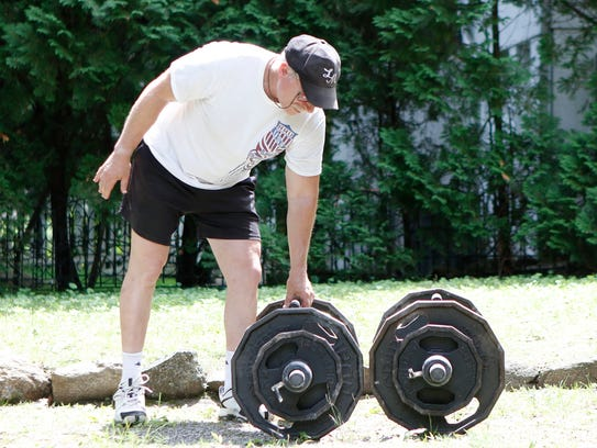 Robert Herbst, 59, a champion weightlifter, prepares