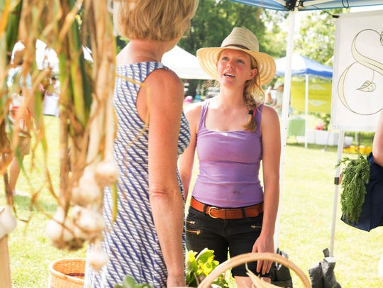 Linda Ashford, left, talks with Sounding Stone Farm