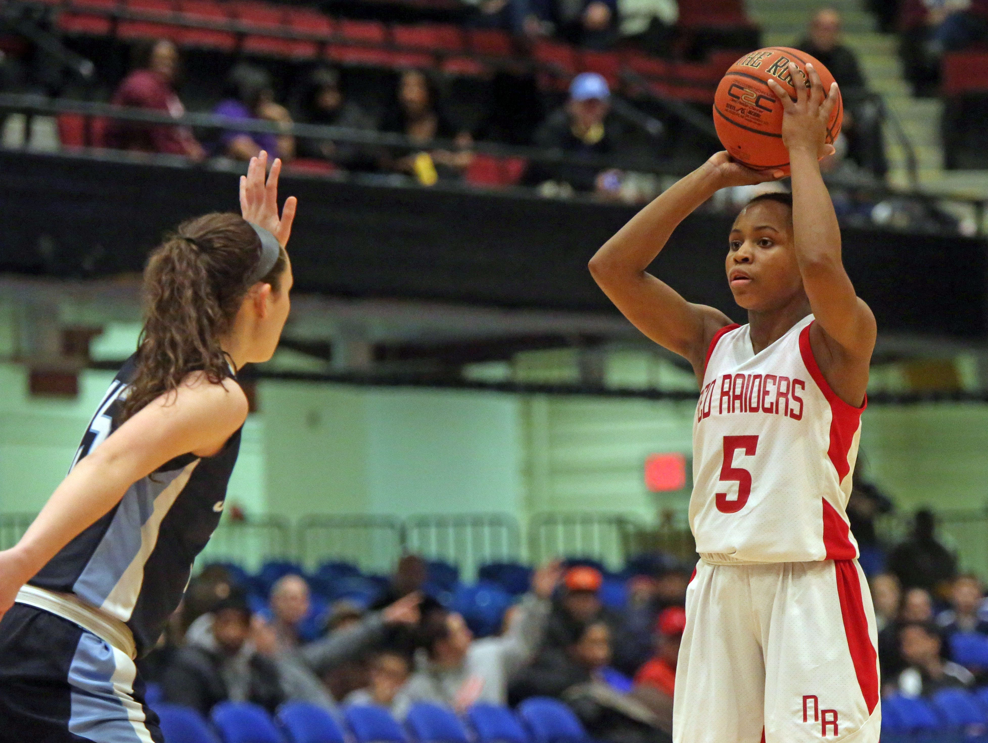 North Rockland's Gaby Cajou (5) in game action of Class AA Section 1 girls basketball semifinals at the County Center in White Plains Feb. 25, 2016. North Rockland defeats John Jay East Fishkill 56-45 .