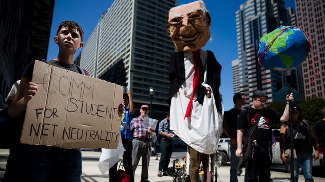 Protesters demonstrate across the street from the Comcast Center in Philadelphia on Sept. 15. They expressed opposition to the proposed merger of communications companies Comcast Corp. and Time Warner Cable Inc., and called for further FCC regulation of Internet traffic to support net neutrality.