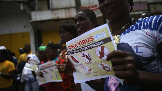 Public health advocates stage an Ebola awareness and prevention event on Aug. 18 in Monrovia, Liberia.