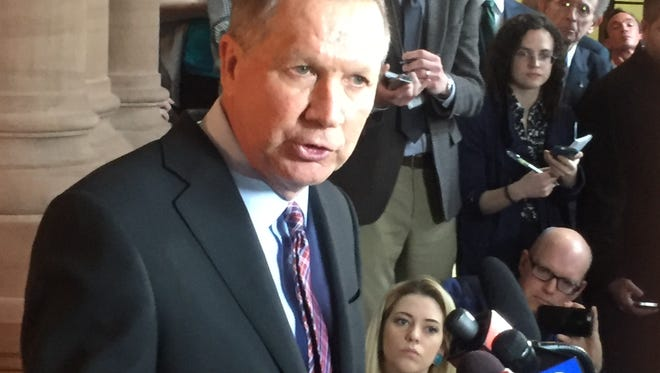 Ohio Gov. John Kasich, a GOP presidential hopeful, speaks with reporters in Albany on April 11, 2016.