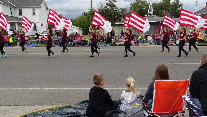 Marion Harding High School's color guard twirled popcorn-themed flags at the parade Thursday.