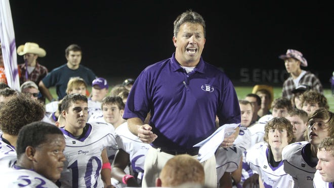 Coach Brett Comer of Brownsburg talks to his team after the win. Zionsville hosted Brownsburg in high school football Friday October 7, 2011. Rob Goebel/The Star.