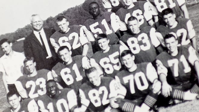 Lynn Weaver in a 1966 West High School football team yearbook in Knoxville, Tennessee on Wednesday, April 4, 2018.