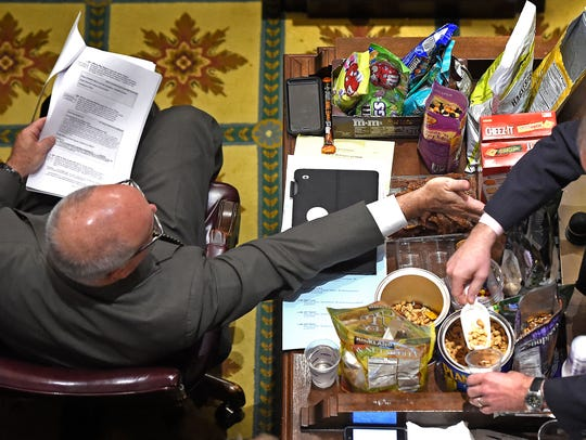 Rep Roger Kane R-Knoxville, left, has an open snack
