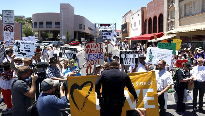 Protesters block the street to the DeConcini port to Mexico at the Families Belong Together march in Nogales on June 30, 2018.