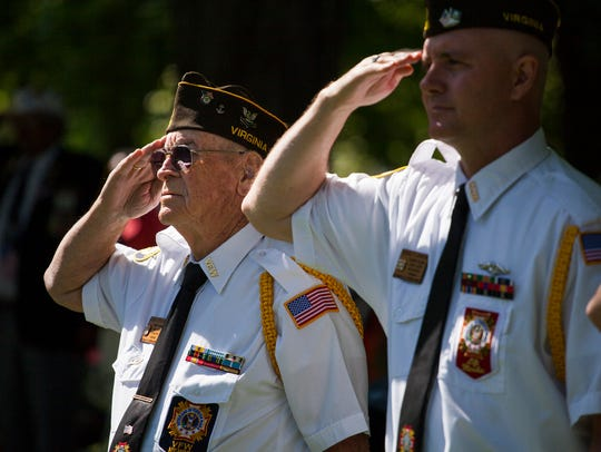 Members of VFW Post 2216 salute during the Pledge of