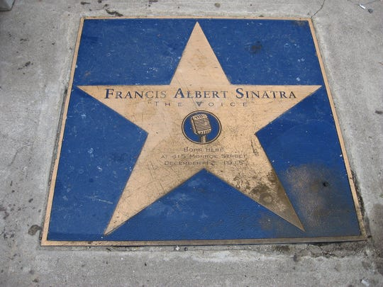 A star honors Frank Sinatra outside his birthplace in Hoboken.