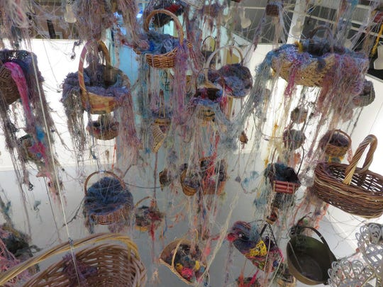 """Threads: Gathering My Thoughts"" is a yarn installation"