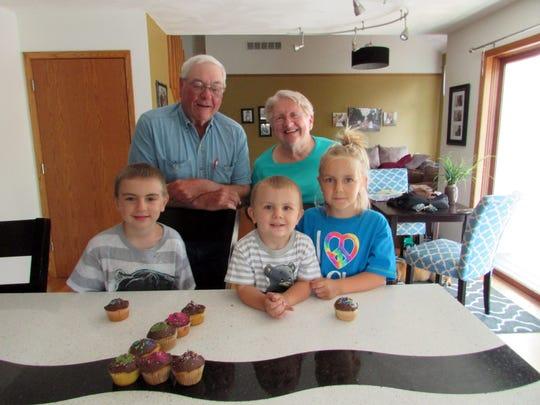 Bob and Susan join their grandchildren, Eli, Wyatt and Arianna, for birthday cupcakes.