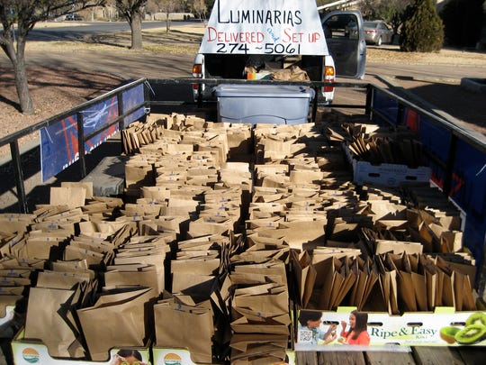 The Luminaria Depot in El Paso sets up hundreds of luminarias for clients who need help or don't want to do it. Pictured are hundreds of folded brown paper bags, waiting to be turned into luminarias.