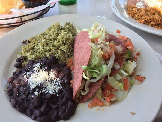 Tacos with beans and signature green rice at Cicada.
