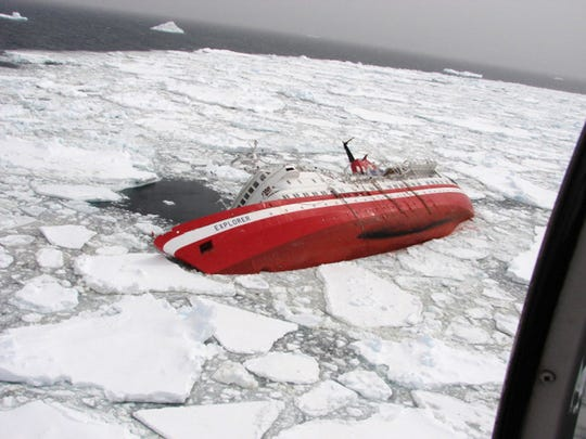 The MS Explorer tips after hitting an iceberg on Nov. 23, 2007. The cruise liner hit an iceberg off Antarctica, and other ships rushed to rescue more than 150 people who took to the freezing seas in lifeboats.
