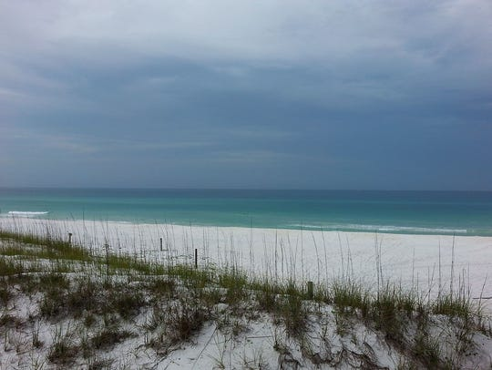 On an overcast morning, seafoam and blue waters soothe