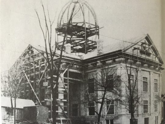 The 1897 Courthouse under construction with the dome's