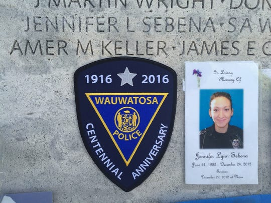 A photograph of former Wauwatosa police officer Jennifer Sebena and a patch from the department is pictured in front of the National Law Enforcement Officers Memorial in Washington D.C. Sebena was killed by her husband while on duty on Christmas Eve in 2012 and members of the Wauwatosa Police Department honored her memory during the annual Police Unity Tour.