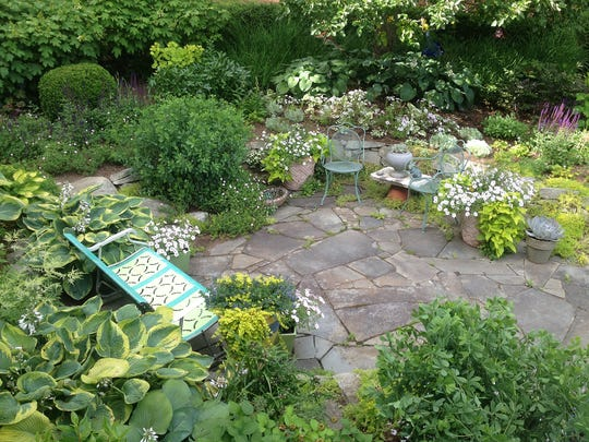 The garden of Teri Condon,  Gardensmith Design in Highland is woven together with stepping stone paths.