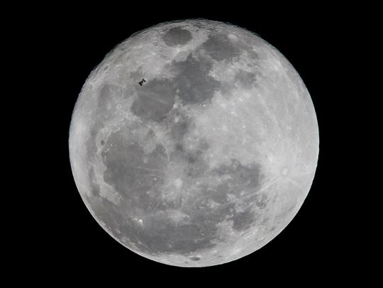 The full flower blue moon will rise at 5:11 p.m. Saturday.