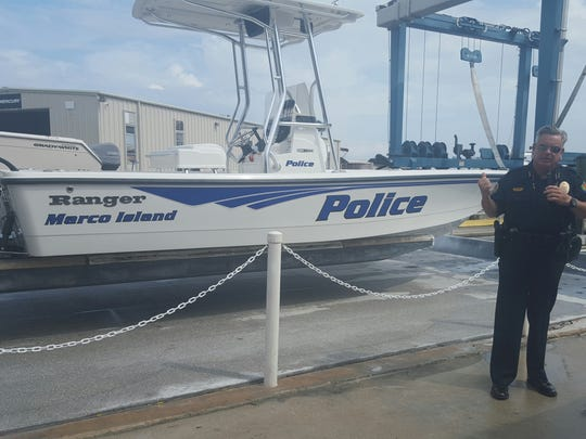 Marco Island Police Department Chief Al Schettino speaks at the commissioning ceremony for the department's new boat.