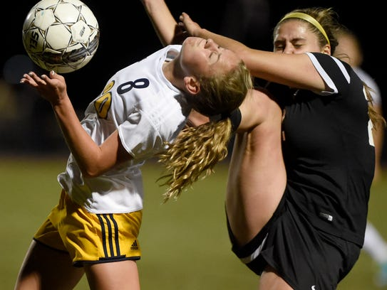 Elco's Cassie Johnson gets tangled up with the ball