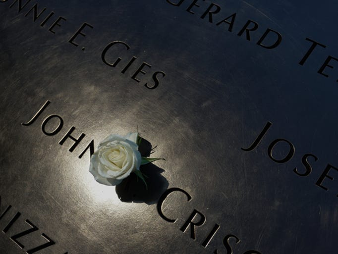 A white rose marks the name of a person who died during the 2001 attack on the World Trade Center.