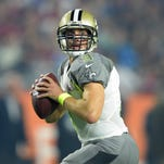 In this file photo, New Orleans Saints quarterback Drew Brees drops back to pass during the 2015 Pro Bowl. Brees will be the keynote speaker at The Clarion-Ledger's Best of MS Preps banquet on May 28.