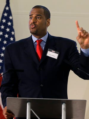 Former NBA basketball player Jayson Williams addresses a gathering at a prisoner re-entry conference in Jersey City, N.J., Thursday, April 17, 2014. Williams, 46, was an all-star professional basketball player who later achieved notoriety for mishandling a shotgun while showing it to friends inside his New Jersey home, killing the driver he'd hired for the night. Williams says trying to re-enter society after serving 18 months in jail for shooting a limousine driver was more difficult than being in prison. (AP Photo/Mel Evans)