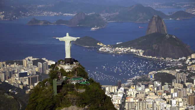 The Christ the Redeemer statue overlooks Guanabara Bay, which will host Olympic sailing and is repository for Rio's sewage.