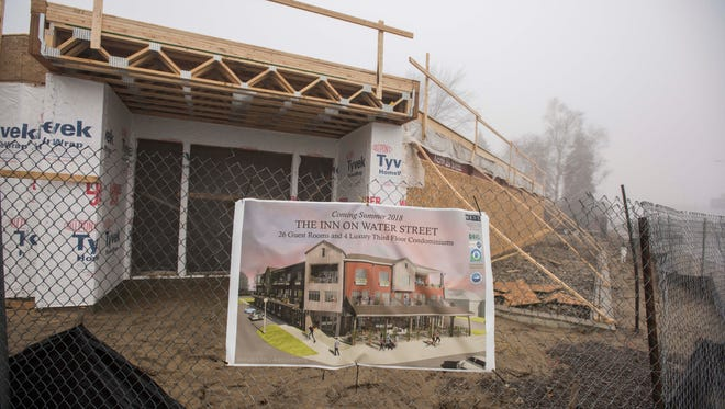 A rendering is displayed on a fence Sunday, Jan. 22, at the site of the future Inn on Water Street in Marine City.