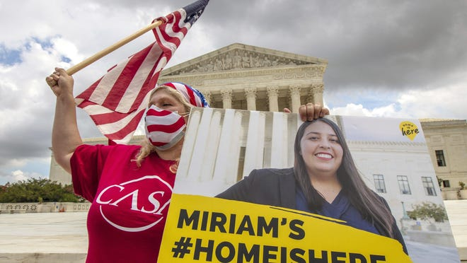 Ivania Castillo from Prince William County, Va., shows her support for dreamer Miriam from California, as she joins DACA recipients in front of the U.S. Supreme Court.