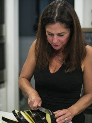 Meredith Bonny of Rosemary Fresh, a homemade delivery and catering company in Easton, cuts an eggplant during her virtual cooking class in her kitchen on Sunday, Sept. 6, 2020.
