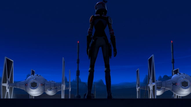 "Sabine (voiced by Tiya Sircar) eyes doing some damage to the Empire's TIE Fighters in ""Star Wars Rebels."""