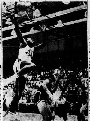 TWO FOR LATTIN - David Lattin (43) goes high with a spectacular hook shot as the undefeated Texas Western Miners downed West Texas State 69-50 Saturday night at Memorial Gym. Lattin scored 26 points during the game. Looking for a possible rebound are West Texas players BVrn Furlow (52) and Cal Taylor (30).