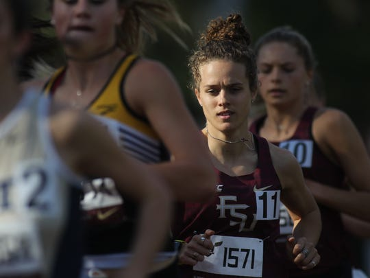 FSU's Maddie Harris runs a distance race at the FSU Relays.