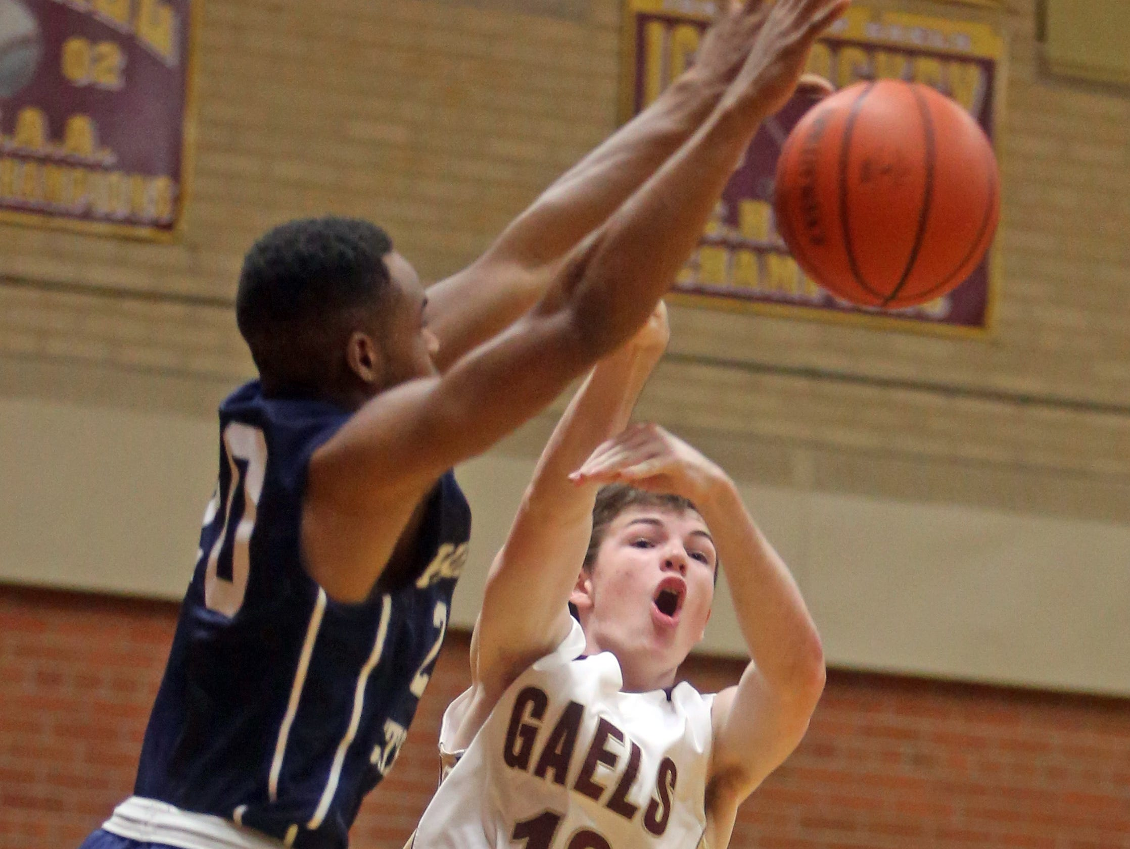 Kennedy Catholic's Alex Benson blocks a shot by Iona Prep's Kevin Fee during a varsity basketball game at Iona Prep in New Rochelle Dec. 9, 2015. Iona Prep defeated Kennedy 75-49.
