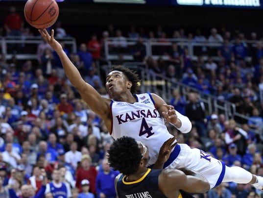NCAA Basketball: Big 12 Conference Tournament-Kansas vs West Virginia