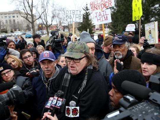 Activist, documentarian and Flint native Michael Moore address a large crowd about the ongoing Flint water crisis in front of the City of Flint Municipal Center on Saturday, Jan. 16, 2016.