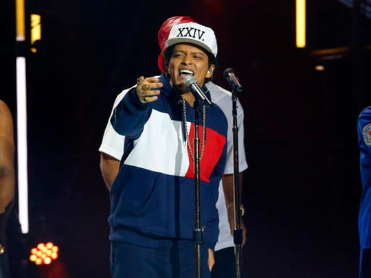 """FILE - In this Nov. 6, 2016 file photo, Bruno Mars performs during the MTV European Music Awards 2016, in Rotterdam, Netherlands. Mars' newest album, """"24K Magic,"""" comes out on Friday, Nov. 18."""