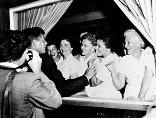 Waitresses meet presidential candidate John F. Kennedy